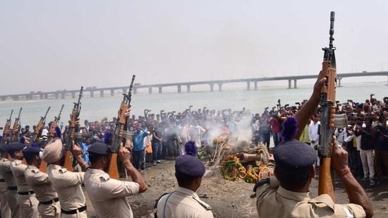 Ayodhya: Cremation of CRPF jawan Rajkumar Yadav, who died in a gun battle with Maoist rebels in Chhattisgarh, is performed with gun-salute, in Ayodhya. (PTI Photo)
