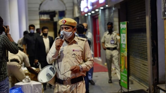 Security personnel during night curfew at Delhi's Connaught Place on Tuesday.(PTI)