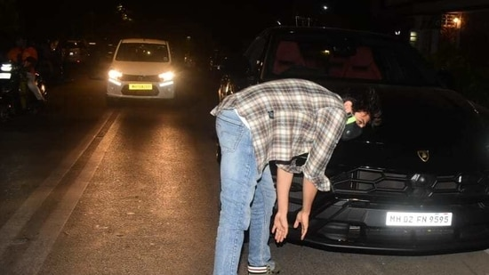 Kartik Aaryan touches lower portion of his new car's front.(Varinder Chawla)