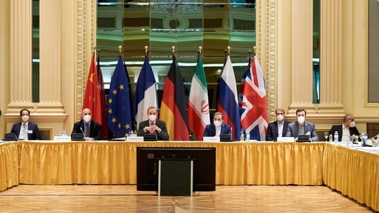 European External Action Service (EEAS) Deputy Secretary General Enrique Mora and Iranian Deputy at Ministry of Foreign Affairs Abbas Araghchi wait for the start of a meeting of the JCPOA Joint Commission in Vienna, Austria April 6, 2021.(Reuters file photo)