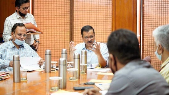 Delhi Chief Minister Arvind Kejriwal in a meeting with senior cabinet minister Satyendra Jain.(ANi file photo)