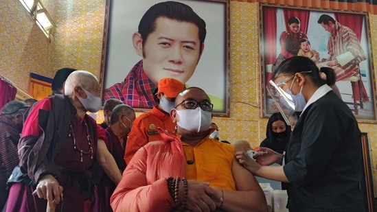 A healthcare worker inoculates a dose of a Covid-19 vaccine to a Buddhist monk in Thimphu on March 27.(AFP Photo)