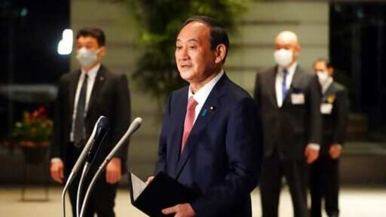 Japanese Prime Minister Yoshihide Suga raised the alert level for Kyoto in western Japan and the southern island prefecture of Okinawa, where cases have surged in recent weeks.(AP)