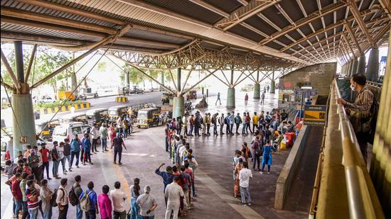 People queue up to give samples for Covid-19 test via RT-PCR, at Turbhe Railway Station in Navi Mumbai, Thursday, April 8. (PTI)