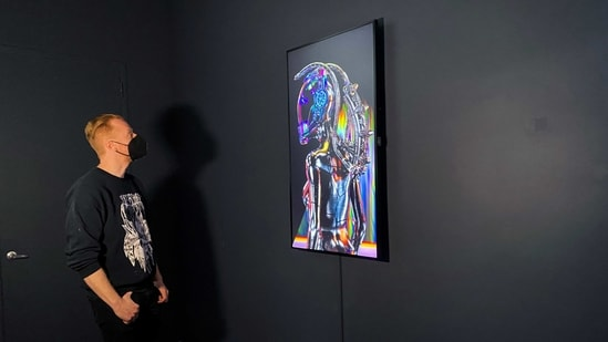 The Superchief Gallery NFT director and co-founder, Ed Zipco is seen in his gallery in the Union Square neighborhood of Manhattan, New York City, U.S., April 7, 2021.(REUTERS)