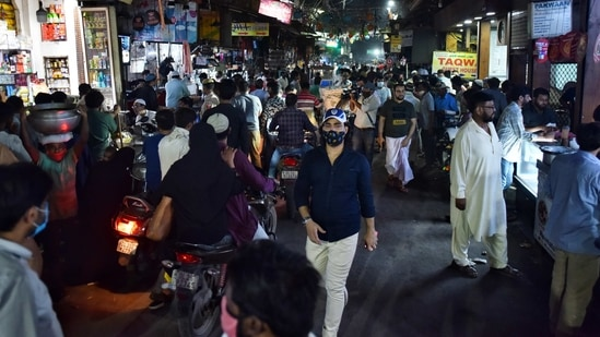 New Delhi, India - April 9, 2021: A rush of people in the Jama Masjid market area despite a night curfew in effect, in New Delhi, India on Friday, April 9, 2021. (Photo by Sanchit Khanna/Hindustan Times)(Sanchit Khanna/HT Photo)