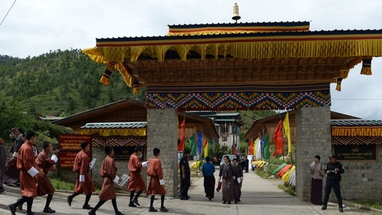 Bhutan and China held the 10th Expert Group Meeting (EGM) on Bhutan-China Boundary. In this photo, Bhutanese college students enter the Royal University of Bhutan in Thimphu. (AFP)