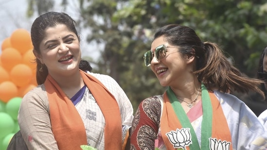 BJP candidates Srabanti Chatterjee, for Behala West, and Payel Sarkar (R), for Behala East, during a roadshow in Kolkata. They are among the many celebrity candidates making their debuts in the political stage for Phase 4 of the 2021 West Bengal Legislative Elections on Saturday. (PTI / File Photo)