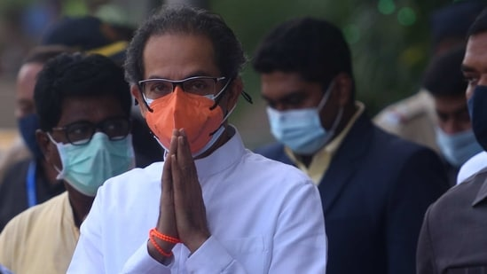 Maharashtra Chief Minister Uddhav Thackeray gestures at the media near Chhatrapati Shivaji Maharaj International Airport, in Mumbai, on Wednesday, March 31, 2021. (Photo by Satish Bate/Hindustan Times)