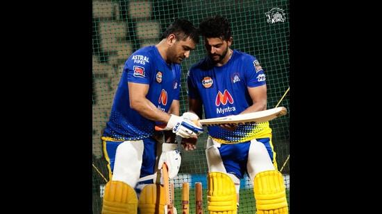 Chennai Super Kings captain MS Dhoni and batsman Suresh Raina inspect a bat in the nets ahead of the IPL.