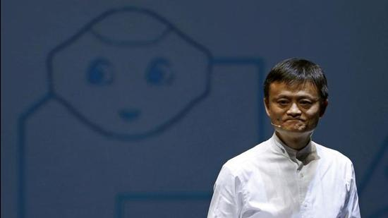In this file photo, Jack Ma, founder and executive chairman of China's Alibaba Group, speaks in front of a picture of SoftBank's human-like robot named 'pepper' during a news conference in Chiba, Japan (REUTERS)