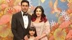Abhishek Bachchan, Aishwarya Rai and Aaradhya pose for a photograph.