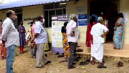 People stand in a queue to receive Covid-19 vaccine during 'Tika (vaccination) Utsav', at a district hospital in Thiruvananthapuram on Sunday. (ANI)