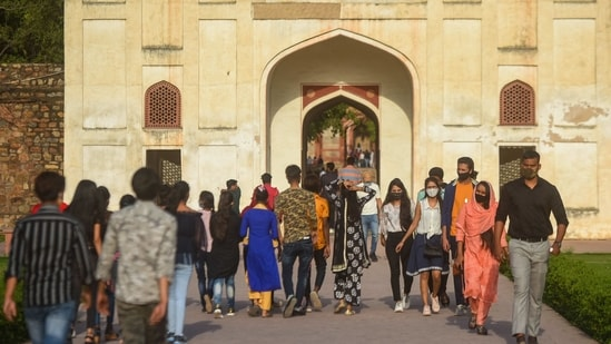 People flout covid norms amid rise in cases, at Humayun's Tomb in New Delhi, India, on Sunday, April 11, 2021. (Photo by Amal KS/ Hindustan Times)(Amal KS/HT Photo)