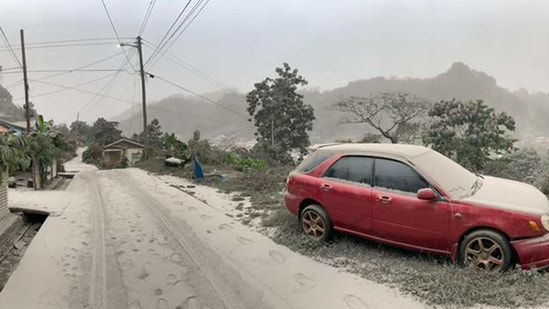 The whitish powder caked roads, homes and buildings in Saint Vincent after the powerful blasts from the volcano called La Soufriere that began Friday and continued into the night.(AFP)
