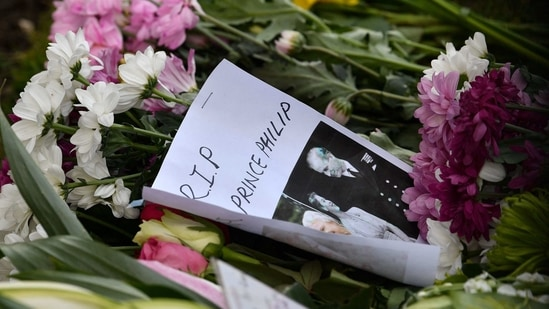 Floral tributes and messages of condolence are seen outside Windsor Castle in Windsor, west of London.(AFP)