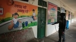 A volunteer disinfects the premises at Seth Anandilal Poddar Government Deaf And Dumb School in Jaipur, Rajasthan. (Himanshu Vyas/ Hindustan Times)