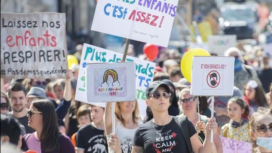 People take part in a demonstration in Montreal, opposing the Quebec administration's health and safety measures to curb the spread of Covid-19 in schools as the pandemic continues in Canada and around the world. (AP)