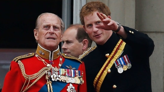 In this June 14, 2014 file photo, Britain's Prince Harry talks to Prince Philip as members of the Royal family appear on the balcony of Buckingham Palace, during the Trooping The Colour parade, in central London. (AP)
