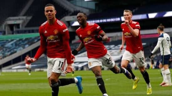 Manchester United's Mason Greenwood celebrates after scoring his side's third goal, left, during the English Premier League soccer match between Tottenham Hotspur and Manchester United at the Tottenham Hotspur Stadium in London, Sunday, April 11, 2021. (Adrian Dennis/Pool via AP)(AP)