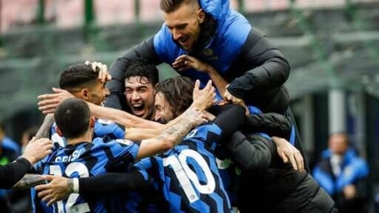Inter Milan's Matteo Darmian, right, celebrates with teammates.(AP)