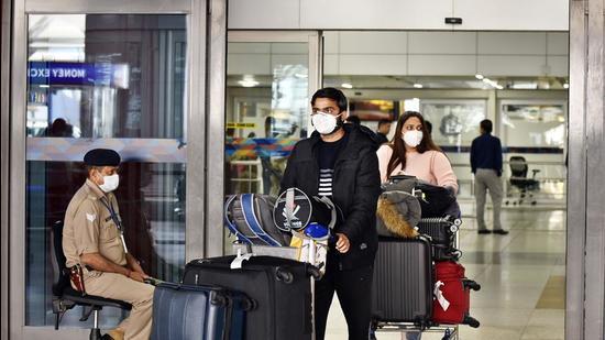 File photo: People seen wearing protective face masks as a precautionary measure amid Covid-19 pandemic at Indira Gandhi International (IGI) Airport, Delhi. (Sanjeev Verma/HT PHOTO)