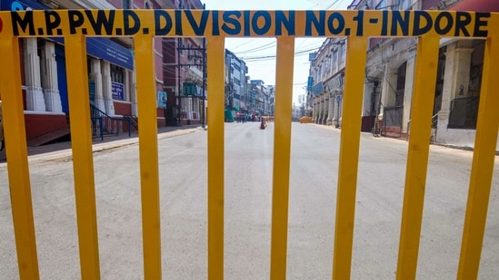 Indore: A city street wears a deserted look on 'Rang Panchami' festival, after authorities imposed restrictions to curb the spread of coronavirus, amid a countrywide spike in COVID-19 cases, in Indore, Friday, April 2, 2021. (PTI Photo) (PTI04_02_2021_000252A)(PTI)