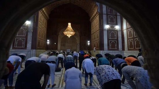 Muslim devotees offer namaz on the eve of Ramzan, in New Delhi, India, on Tuesday, April 13, 2021. (Photo by Sanjeev Verma/ Hindustan Times)