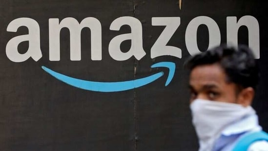 A man walks past an Amazon logo outside the company's collection point in Mumbai. (REUTERS)