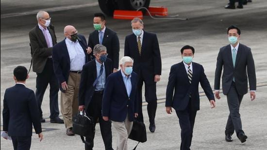 US officials arrive at Songshan airport in Taipei, Taiwan on Wednesday. (REUTERS)