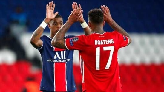 PSG's Presnel Kimpembe, left, and Bayern's Jerome Boateng at the end of the Champions League, second leg, quarterfinal soccer match between Paris Saint Germain and Bayern Munich at the Parc des Princes stadium, in Paris, France, Tuesday, April 13, 2021. (AP Photo/Francois Mori)(AP)