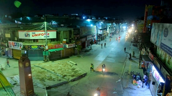 A city street wears a deserted look during night curfew, imposed by authorites amid a surge in coronavirus cases across the country, in Amravati, Maharashtra. (PTI Photo)