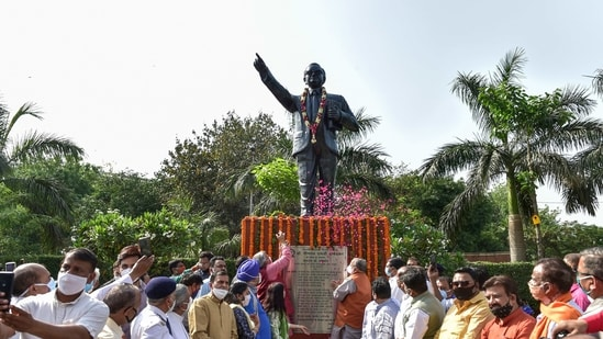 Delhi BJP chief Adesh Gupta, mayor North Delhi MCD Jai Prakash and others inaugurate a statue of Dr. Bhimrao Ambedkar, on the birth anniversary of the Dalit leader, at North DMC HQ in New Delhi on Tuesday. (PTI Photo )