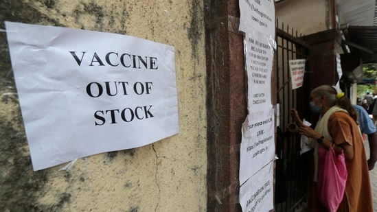 A note informing about the Covid-19 vaccine is seen pasted on a wall of a vaccination centre in Mumbai, India, Thursday, April 8, 2021.(AP)
