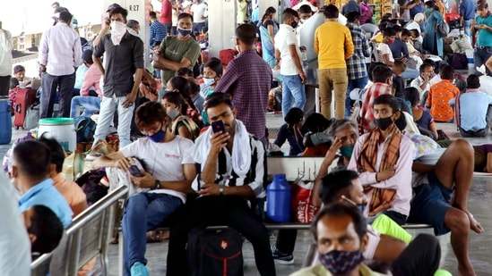 Passengers wait at the station as they arrive to board the train for their hometown amid the surge in Covid-19 cases, at Anand Vihar Railway Station in New Delhi on Wednesday. (ANI)