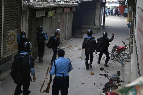 Riot policemen throw stones towards supporters of Tehreek-e-Labbaik Pakistan (TLP) party during a protest against the arrest of their leader as he was demanding the expulsion of the French ambassador over depictions of Prophet Muhammad, in Barakahu neighbourhood of Islamabad. (AFP)