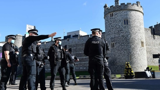 Police are directed to positions at Windsor Castle in Windsor, west of London, on April 14, 2021 as preparations commence for the funeral of Britain's Prince Philip, Duke of Edinburgh.(AFP Photo )