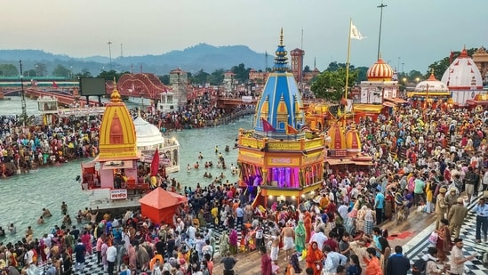 """""""I urge pilgrims to continue with their regular activities only after their COVID negative test report,"""" Dr K Sudhakar said. In picture - People at the Kumbh Mela in Haridwar.(PTI)"""