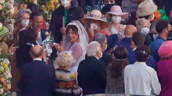 FILE - Lady Gaga, wearing a wedding dress, plays Maurizio Gucci's former wife Patrizia Reggiani during the shooting of a movie by Ridley Scott, based on the story of the murder of Maurizio Gucci in 1995, in Rome, Thursday, April 8, 2021. The great-grandchildren of Guccio Gucci, who founded the luxury brand nearly a century ago in Florence, are appealing to filmmaker Ridley Scott to respect their family's legacy in the film that focuses on the sensational murder. (AP)