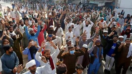 Supporters of Tehreek-i-Labbaik Pakistan, an Islamist political party, chant slogans during a protest in Lahore, Pakistan.(AP)