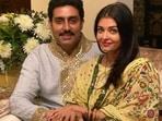 Abhishek Bachchan and Aishwarya Rai Bachchan pose together.