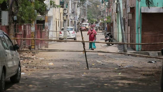 Jaipur: Bamboo poles placed as barricading to keep people inside an area declared a Covid-19 containment zone at Malviya Nagar, in Jaipur, Rajasthan, India on Wednesday, April 14, 2021. (Himanshu Vyas / HT Photo)
