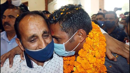 Family members of the CRPF jawan Rakeshwar Singh Manhas celebrate his homecoming in Jammu on Friday. (ANI)