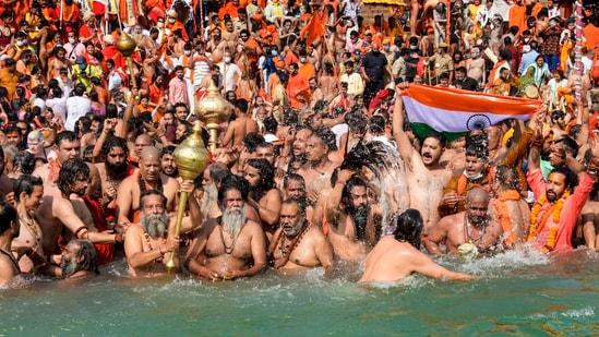 Haridwar: Devotees gather to offer prayers during the third 'Shahi Snan' of the Kumbh Mela 2021, at Har ki Pauri Ghat in Haridwar, Wednesday, April 14, 2021. (PTI Photo)(PTI04_14_2021_000077B)(PTI)