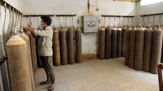 A worker checks the oxygen cylinders, which is used for the treatment of Covid-19 patients, at Patna Medical College.(PTI)
