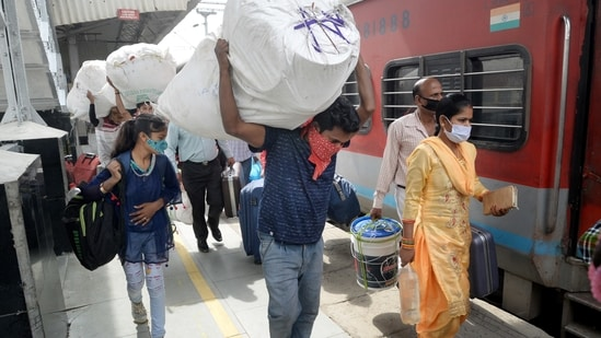 Migrants board a train to their native places in Bihar amid rise in coronavirus cases across the country. (PTI Photo )