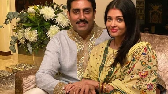 Abhishek Bachchan and Aishwarya Rai Bachchan pose together.