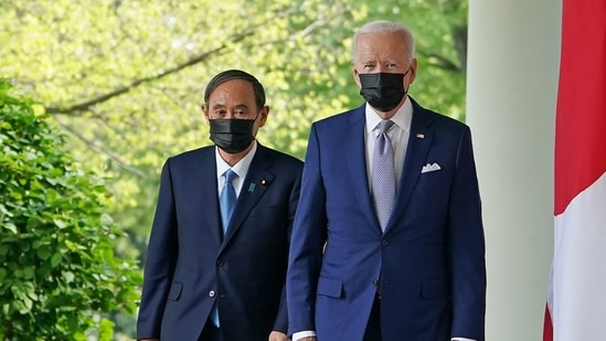 US President Joe Biden and Japan's Prime Minister Yoshihide Suga walk through the Colonnade to take part in a joint press conference in the Rose Garden of the White House in Washington. (AFP)