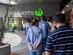 Shoppers line up outside a Woolworths store in Brisbane, Australia. (REUTERS )