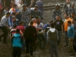Medics carry an injured man at the site where a passenger train derailed injuring at least 100 people, in Banha, Qalyubia province, Egypt, Sunday(AP Photo )